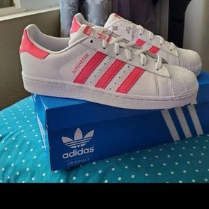 Adidas Shell toe sneakers.